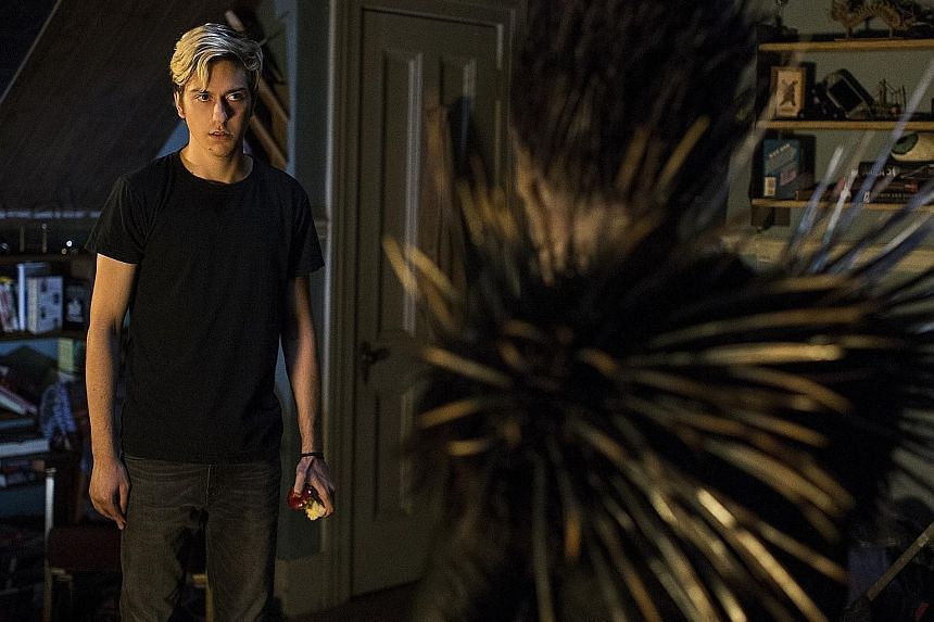 (From far left) Nat Wolff and Willem Dafoe (as god of death Ryuk) in Death Note.