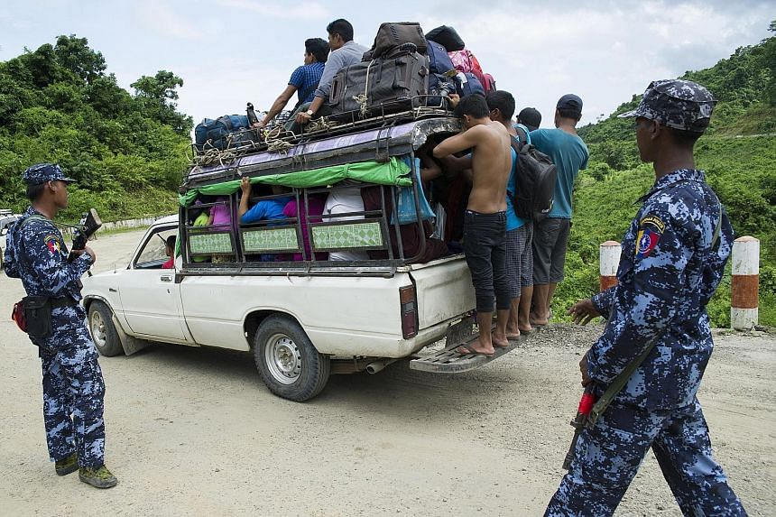 Border police checking people fleeing from a conflict area at a checkpoint near Maungdaw township in Myanmar's Rakhine state on Monday. Rohingya Muslims are trying to escape the latest surge in violence between a shadowy militant group and the milita
