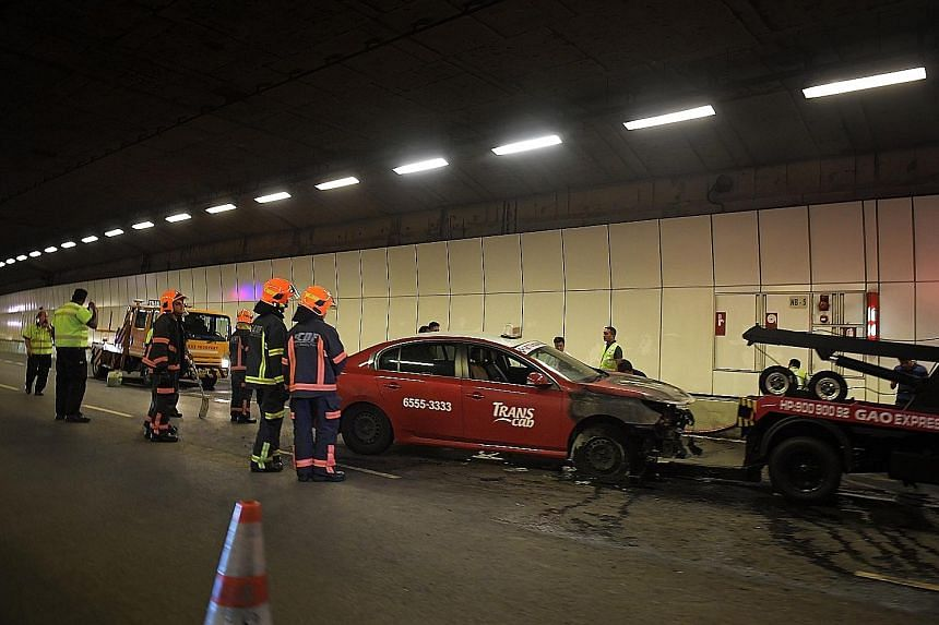A TransCab taxi caught fire in the tunnel at about 7.10pm. The fire involving the engine compartment of the taxi was put out by two members of the public, but it was enough to fill the tunnel with smoke.