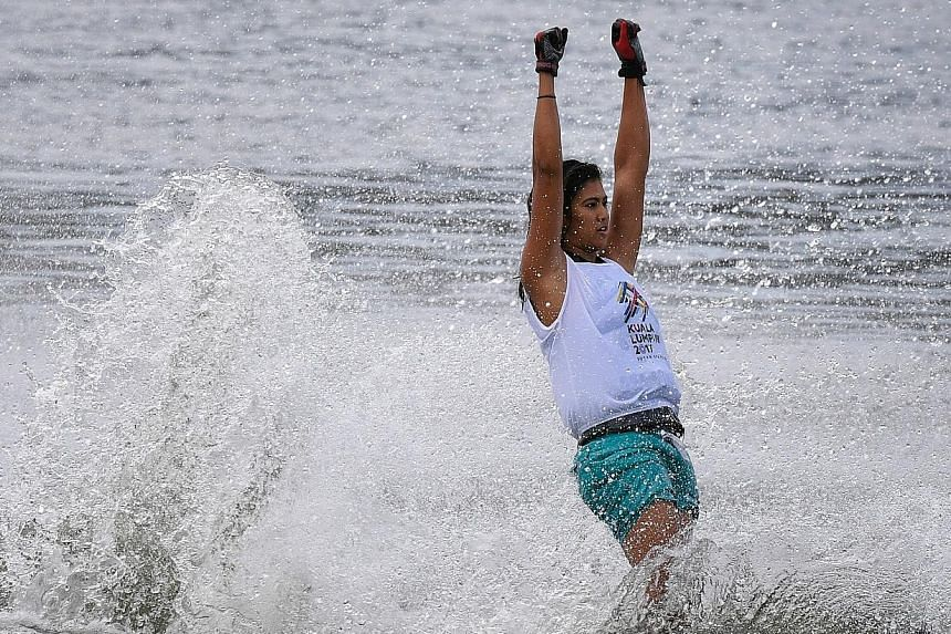 Above: Singapore's Sasha Christian celebrates winning the women's slalom gold. Left: Defending champion Mark Leong of Singapore competing in the men's slalom final. He retained his title with a score of three buoys with a 13-metre rope. VIDEO Sasha C