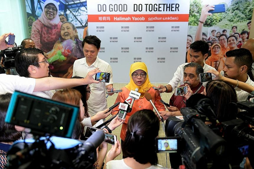 """Madam Halimah Yacob speaking to the media yesterday during her press conference, where she announced her campaign slogan, """"Do Good Do Together""""."""