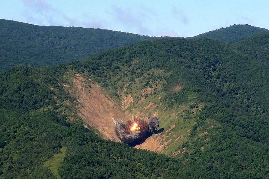 Bombs dropped by South Korean F-15 fighter jets hitting a simulated target in South Korea's eastern province of Gangwon yesterday, hours after North Korea fired a missile that flew over Japan. Officials said the exercise shows that the South can wipe