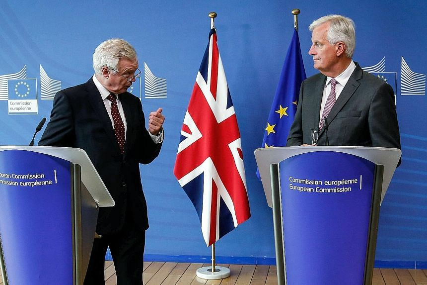 Mr David Davis (left) with Mr Michel Barnier at a news conference ahead of the latest round of Brexit negotiations in Brussels on Monday.