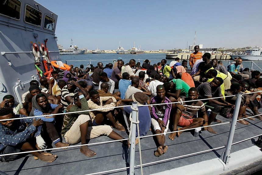 Illegal migrants arriving via boat at a naval base in Tripoli after being rescued by the Libyan coast guard on Monday.