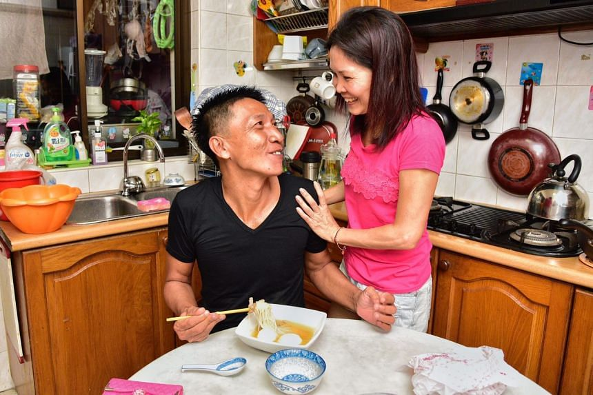 Boat captain Shoo Chiau Huat, 51, with his Wife Jasmine in his home .