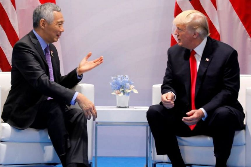 PM Lee and Donald Trump will meet at the White House in October, after meeting for the first time (above) on the sidelines of the Group of 20 Leaders' Summit in July 2017.