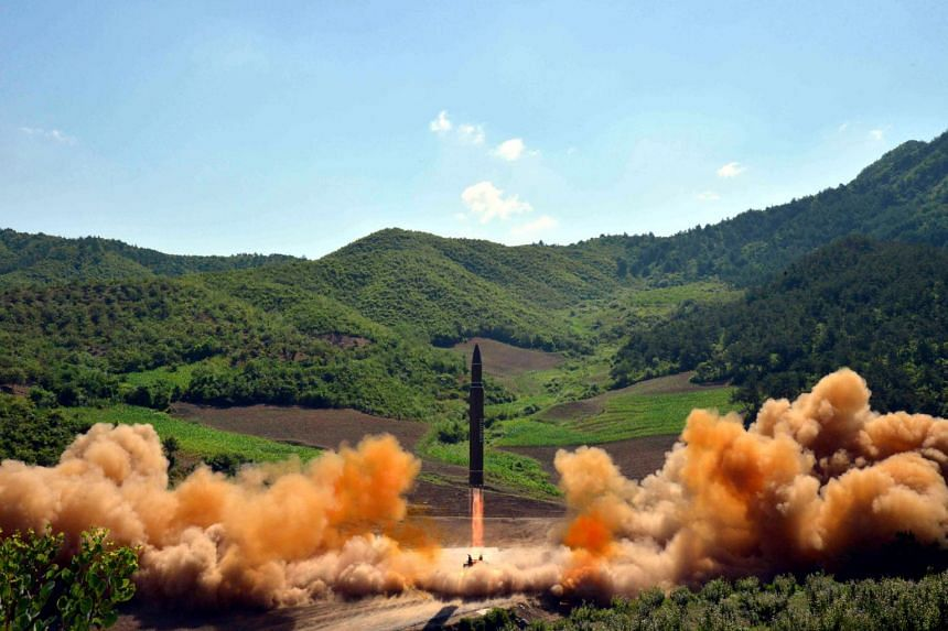 North Korean inter-continental ballistic rocket Hwasong-14 being launched at an undisclosed location in North Korea.