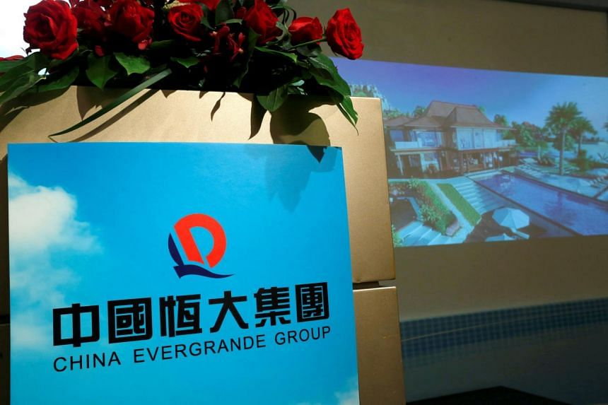 A promotional footage on a property development of China Evergrande Group is shown at a news conference on the company's interim results in Hong Kong, on Aug 30, 2016.