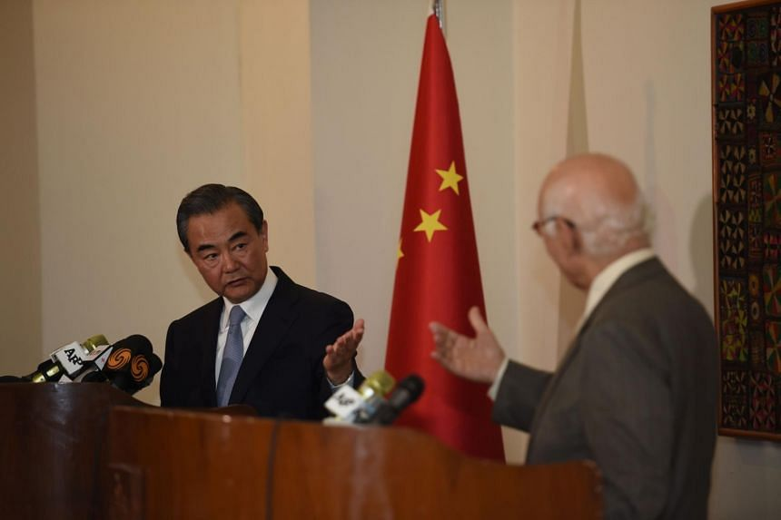 Chinese Foreign Minister Wang Yi (left) and Pakistani Advisor to the Prime Minister on National Security and Foreign Affairs Sartaj Aziz attend a press briefing at the Nor Khan Air base in Rawalpindi on June 25, 2017.