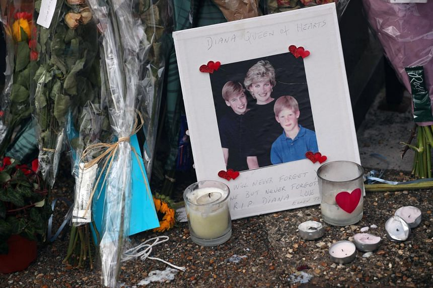 Flowers and tributes in memory of the late Princess Diana are placed on the gates of her former residence Kensington Palace in London, on Aug 29, 2017.