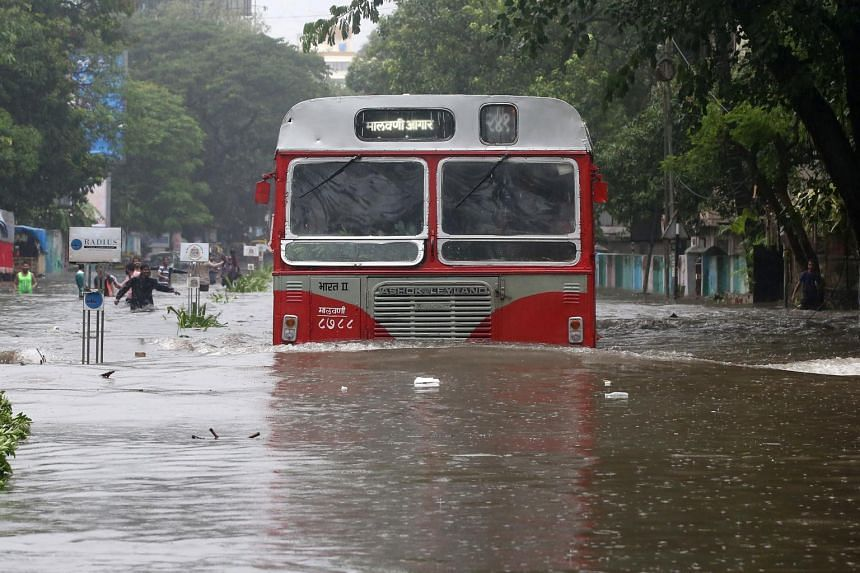 A passenger bus moves through a water-logged road during rains in Mumbai, on Aug 29, 2017.