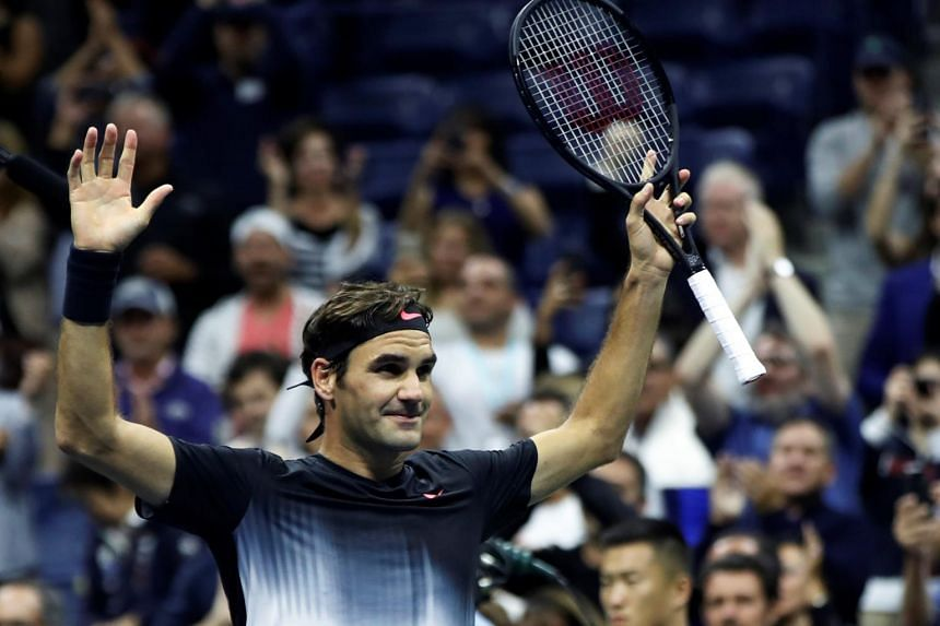 Roger Federer celebrates his win against Frances Tiafoe during their first round match.