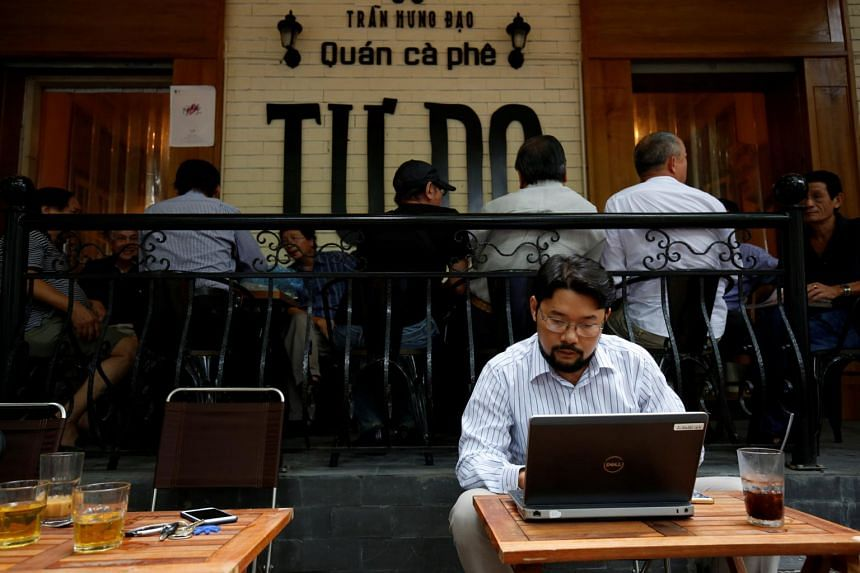 Vietnamese activist Anh Chi searches the Internet at Tu Do (Freedom) cafe in Hanoi.