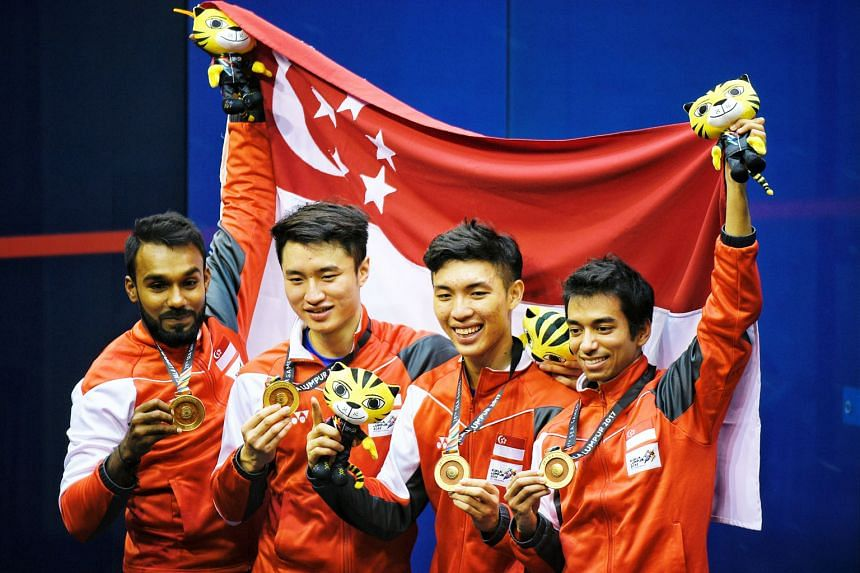 From left: Vivian Rhamanan, Pang Ka Hoe, Benedict Chan and Samuel Kang showing off their gold medals yesterday. Of the four, only Rhamanan is a professional player, like many others in the region. Pang and Chan have both just finished national servic