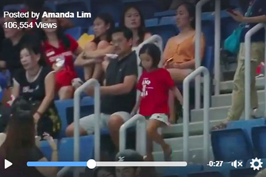 Eight-year-old Caitlin Chan descending the stairs at KL's National Aquatic Centre in a failed bid to greet swimmer Amanda Lim after her 50m freestyle win.