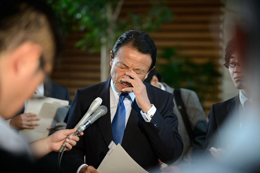 Japanese Deputy Prime Minister and Finance Minister Taro Aso pausing while speaking to the media at the official residence of Prime Minister Shinzo Abe in Tokyo yesterday.