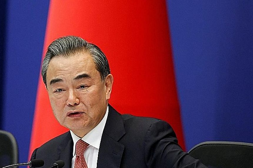 """Chinese Foreign Minister Wang Yi said it is normal for the neighbours to have differences. """"What's important is we put these problems in the appropriate place, and appropriately handle and control them..."""""""