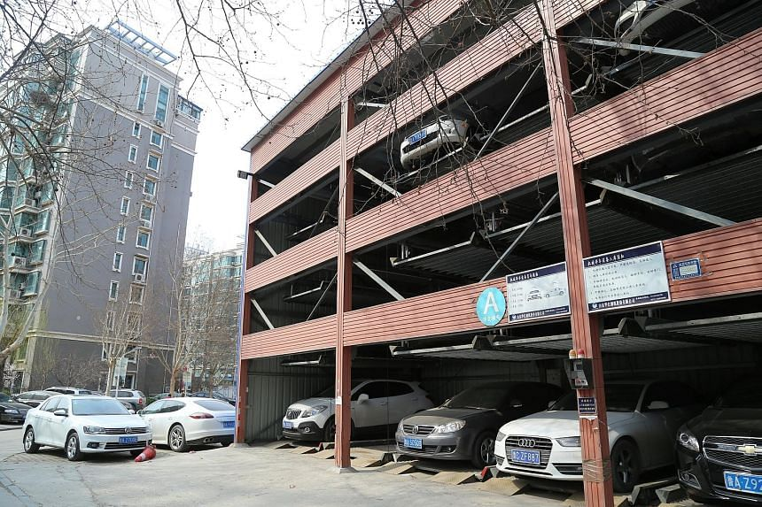 In some cities, million-yuan parking spaces are sold with an apartment worth as little as 2.4 million yuan, in bundled deals that make it compulsory for residents to purchase the parking space.