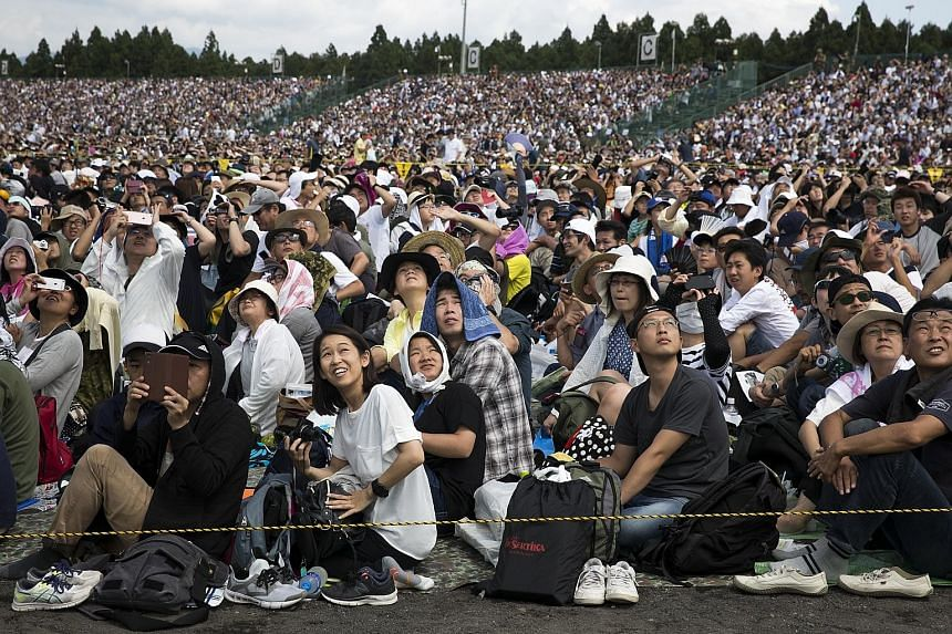 Spectators watching live-fire drills by Japan's Self-Defence Forces in the foothills of Mount Fuji in Gotemba on Sunday.
