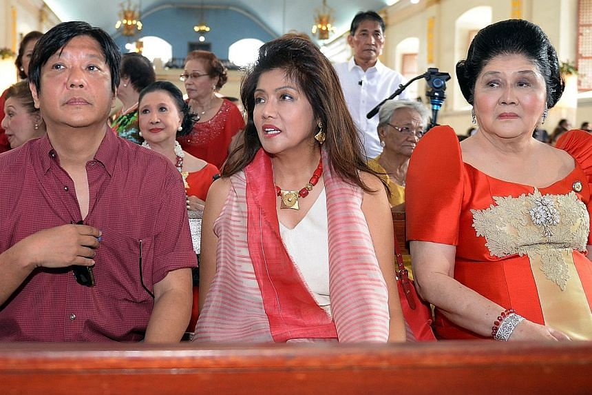 Senator Ferdinand Marcos Jr with his sister, Governor Imee Marcos, and mother Imelda attending mass during the birthday celebration of the former first lady at a church in Laoag City, northern Philippines, in this photo taken on July 2, 2014.