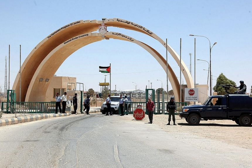 Jordanian security personnel at the Karameh border crossing in this file photo taken on June 25, 2014. The reopening of the post is a sign of increasing stability in the area.