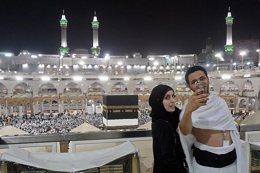 Pilgrims taking a wefie at the Grand Mosque in Mecca yesterday. Over 100,000 security personnel have been mobilised for the haj, to avoid a repeat of the stampede in 2015 in which nearly 2,300 were killed.