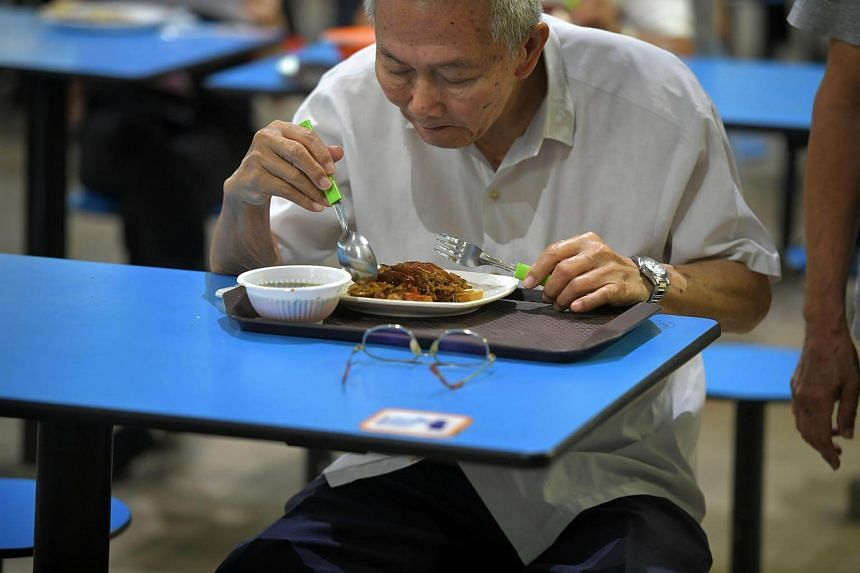File photo of an elderly man having his meal at Bedok Interchange Hawker Centre.