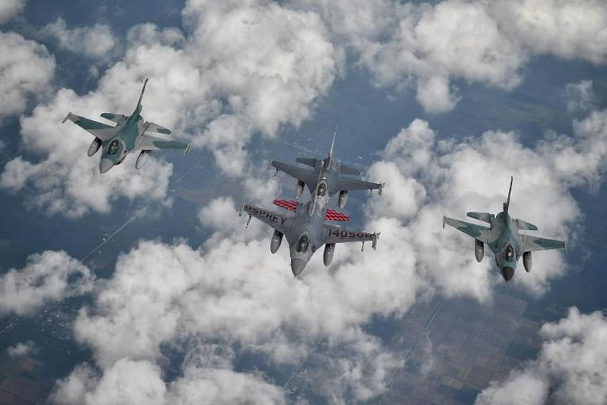 Two RSAF F16s (front and back) and two TNI-AU F16s (left and right) conducting work-up training for the combined flypast within Singapore and Indonesia airspace.