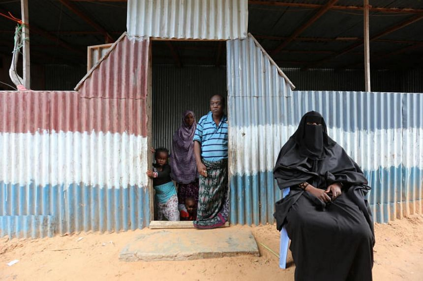 Family members mourn Mohamed Mohamud who was killed in an attack by Somali forces supported by U.S. troops in Bariire village in Mogadishu Somalia, on Aug 29, 2017.