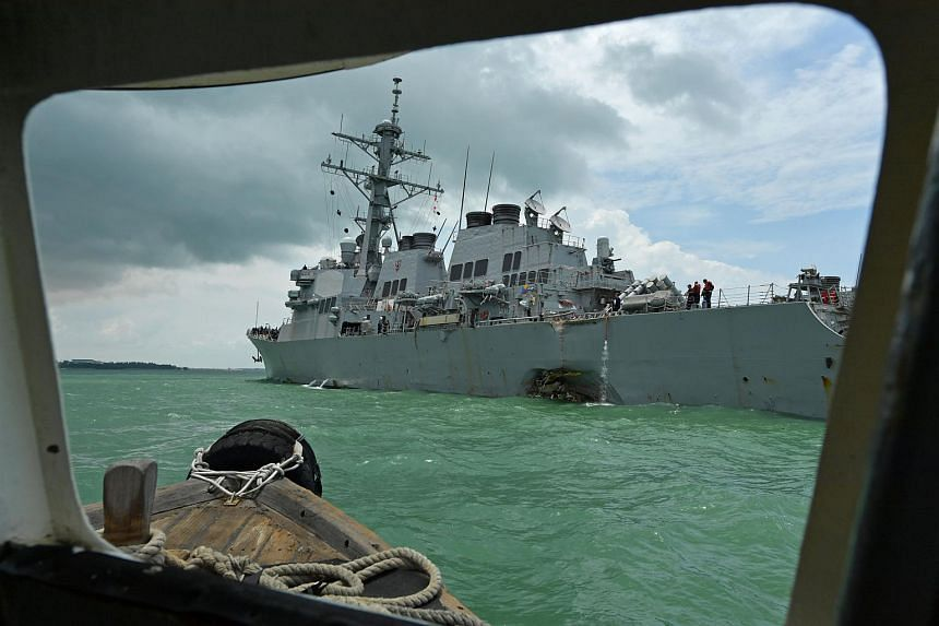 The damaged USS John S. McCain is seen off Changi Naval Base, after colliding with a tanker, on Aug 21, 2017.