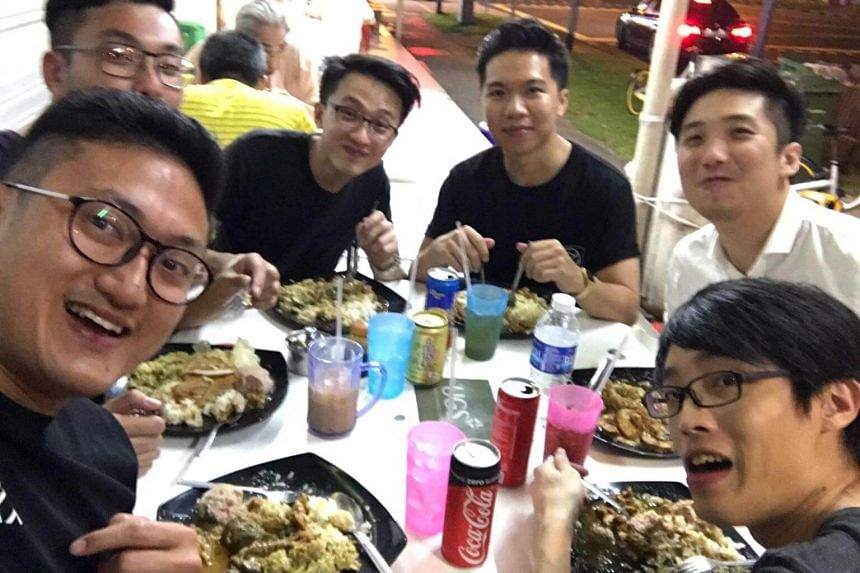 Justinian Tan, 24, (third from left), seen here with his friends having supper in Johor Bahru before the accident.