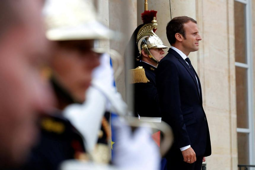 French President Emmanuel Macron waits for guests at the Elysee Palace in Paris, France on Aug 31, 2017.