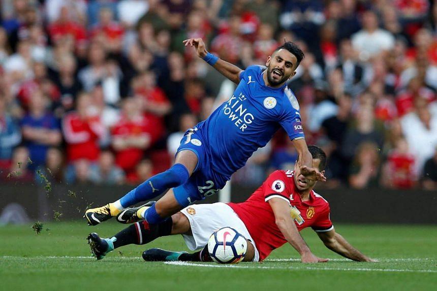 Leicester City's Riyad Mahrez is fouled by Manchester United's Henrikh Mkhitaryan on Aug 26, 2017.