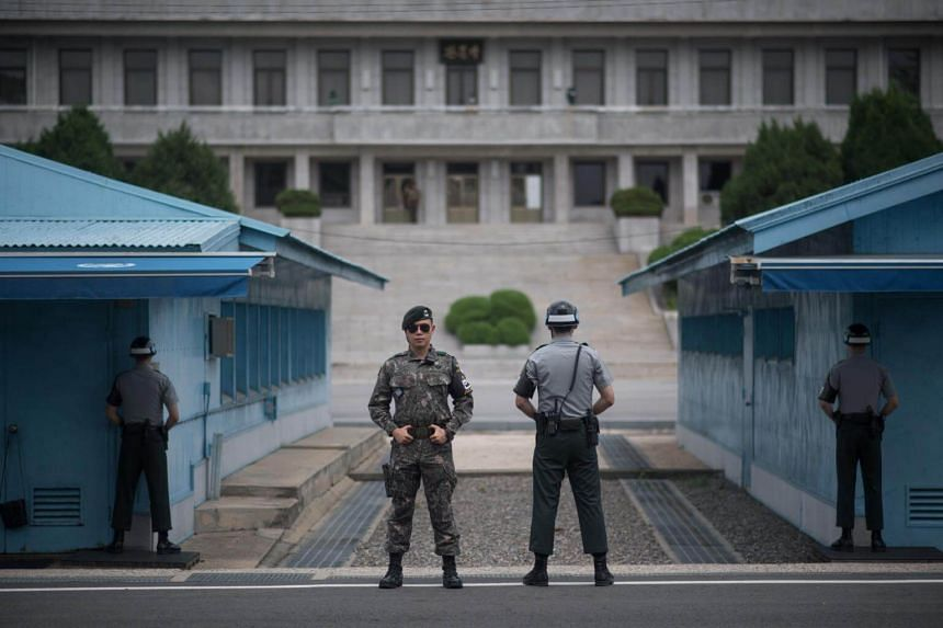 South Korean soldiers standing guard at the Joint Security Area in Panmunjom, on the border with North Korea, on Aug 2, 2017.