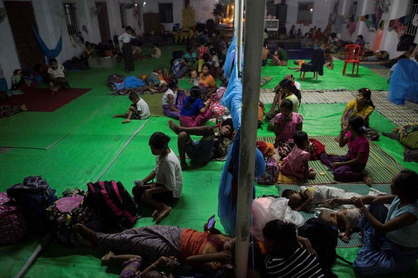 Ethnic Rakhine children who escaped from unrest taking a rest at a temporary shelter in Sittwe, Rakhine State on Aug 30, 2017.