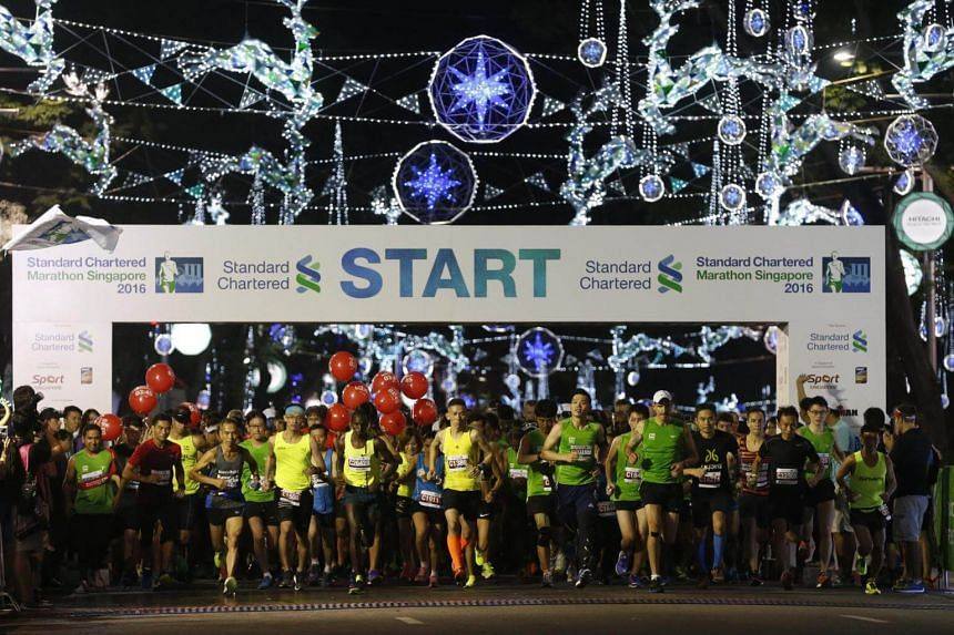 The main group of runners being flagged off at Orchard Road at the start of the Standard Chartered Marathon Singapore 2016 held on 4 December.