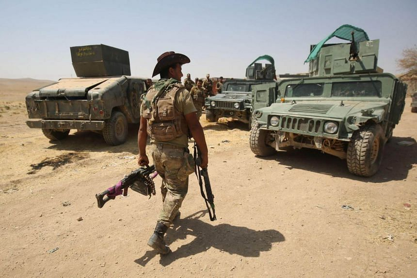 Iraqi forces advance towards the al-Ayadieh area, north of Tal Afar, during the ongoing battle to oust the last pockets of Islamic State group jihadists from the area on Aug 30, 2017.