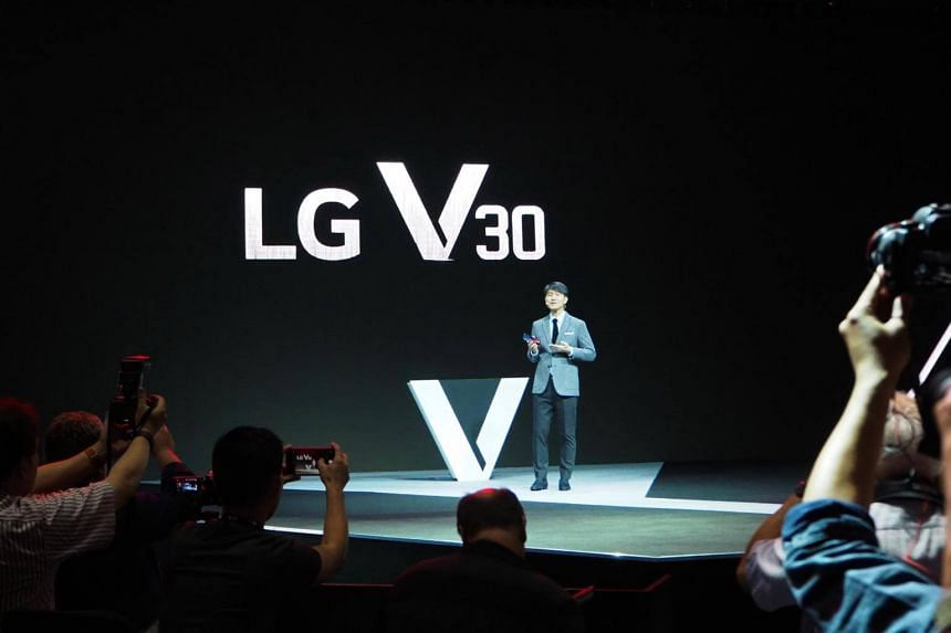 Juno Cho, mobile communication president of LG Electronics, launches the V30 smartphone during a press conference in Berlin.