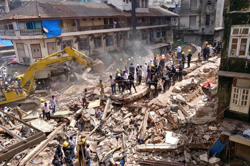 Firefighters and rescue workers search for survivors at the site of a collapsed building in Mumbai, India, on Aug 31, 2017.