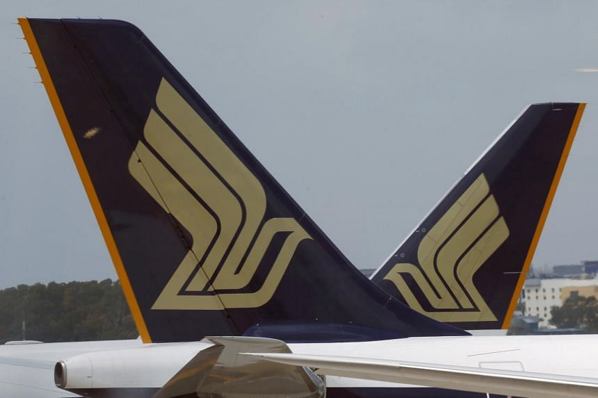 Singapore Airlines (SIA) planes sit on the tarmac in Singapore's Changi Airport.