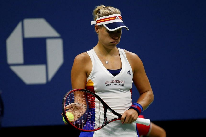 Angelique Kerber of Germany reacts to a lost point against Naomi Osaka of Japan during their first round match.