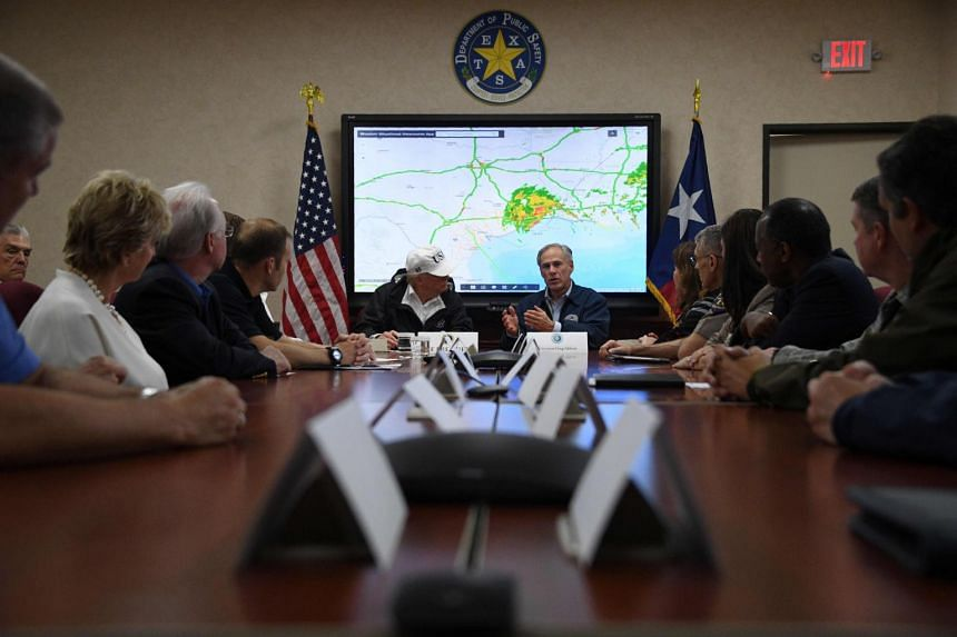 Texas Governor Greg Abbott speaks next to US President Donald Trump at the Texas Department of Public Safety Emergency Operations Centre in Austin, Texas on Aug 29, 2017.