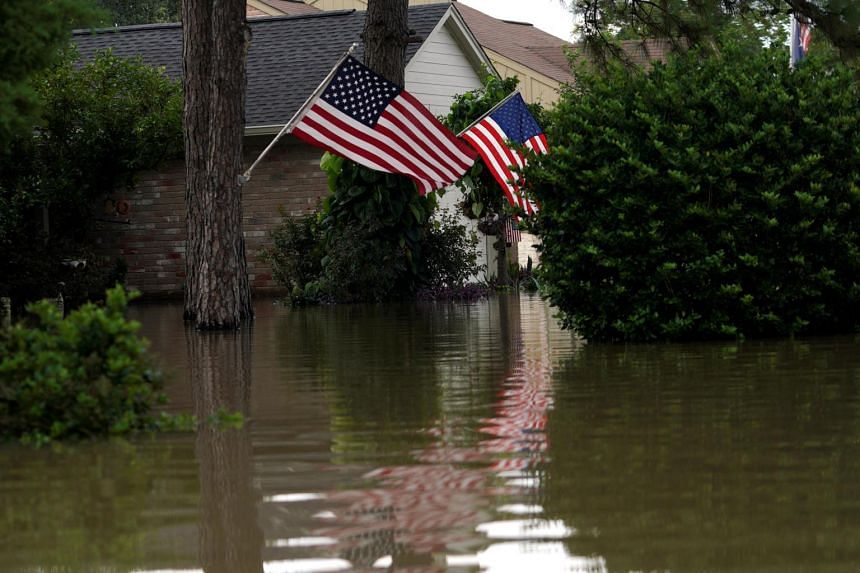 US flags are reflected in the Tropical Storm Harvey floodwaters in north western Houston.