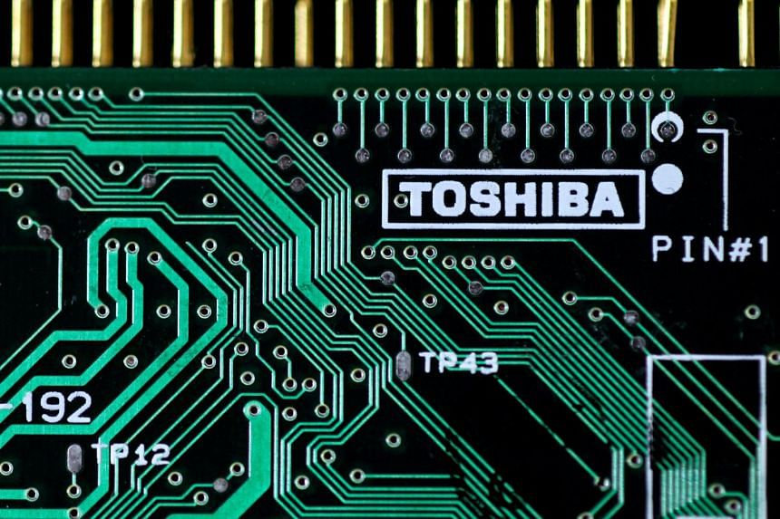 A logo of Toshiba Corp is seen on a printed circuit board in this photo illustration taken in Tokyo.