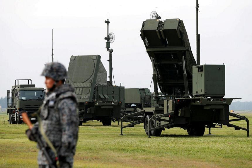 A Japan Self-Defense Forces (JSDF) soldier takes part in a drill to mobilise their Patriot Advanced Capability-3 (PAC-3) missile unit in response to a recent missile launch by North Korea.