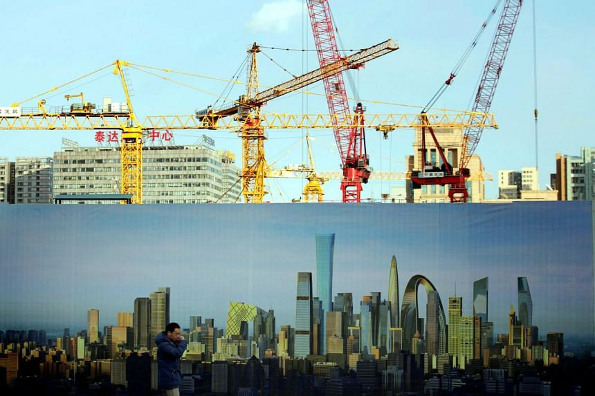 A construction site in Beijing. Top destinations for Singapore capital in the first half of 2017 include the United States, China and Australia.