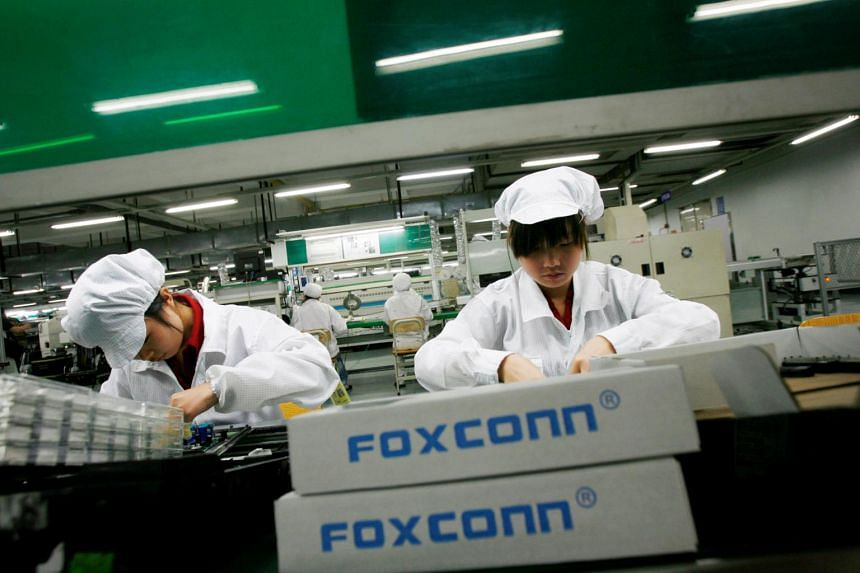 Employees work inside a Foxconn factory in the township of Longhua in the southern Guangdong province, China.