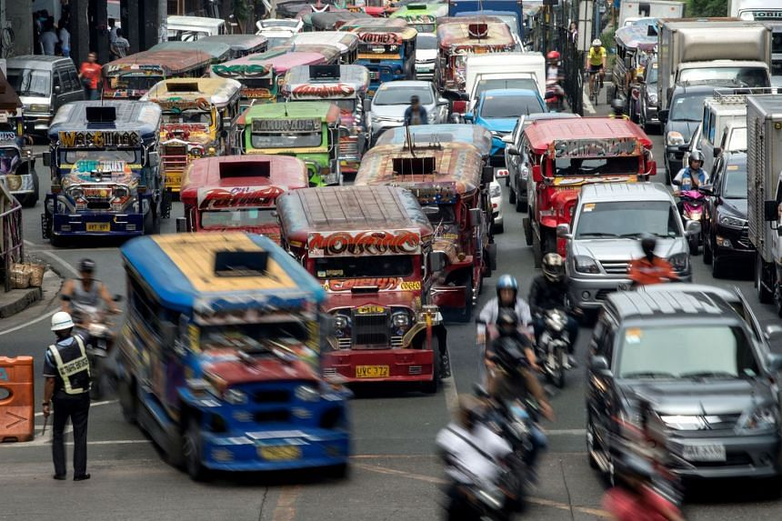 Singapore and the Philippines have signed a Memorandum of Understanding for the republic to help develop systems to solve Manila's traffic woes. Jeepneys, seen here, are a staple on Manila's gridlocked streets.