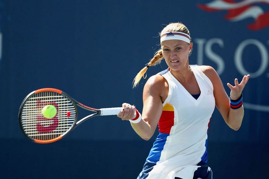 Mladenovic returns a shot to Monica Niculescu of Romania during their first round match.