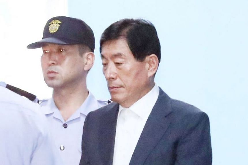 Won Sei Hoon being taken to a detention centre after the Seoul High Court sentenced him to four years in prison.